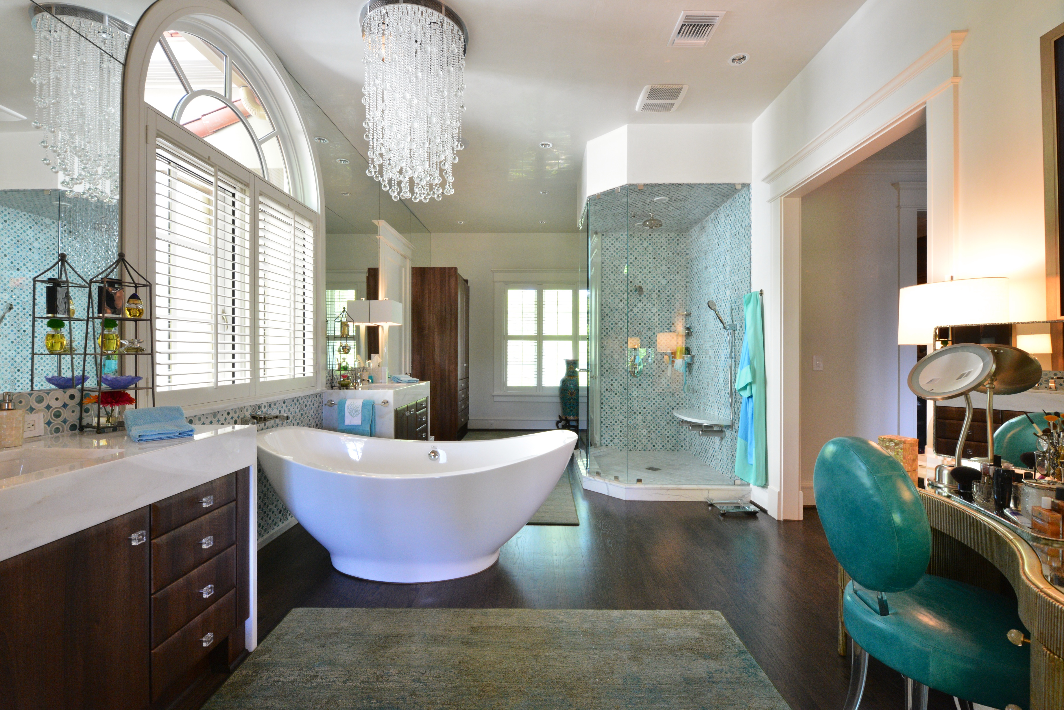 Beautiful bathroom with accent tub and pops of turquoise color